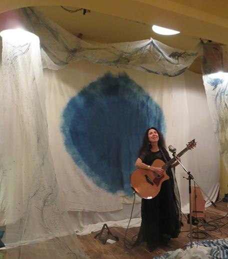 10-14-19-Japan-Kobe-Modernark-Alicia on stage w guitar modeling Little Eagle dress